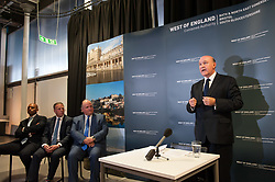 © Licensed to London News Pictures. 08/05/2017. Bristol, UK. TIM BOWLES for the Conservatives is sworn in as the West of England Combined Authority Mayor, at a ceremony at The Engine Shed in Bristol, following his election victory in the mayoral elections last Friday. He is watched by the leaders of the three local authorities he will work with, from left: Marvin Rees mayor of Bristol, Tim Warren leader of Bath and North East Somerset, Matthew Riddle leader of South Gloucestershire. Photo credit : Simon Chapman/LNP