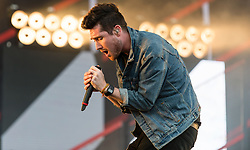 © Licensed to London News Pictures. 28/08/2015. Reading Festival, UK. Bastille  performing at Reading Festival on Day 1 of the festival.  In this picture - Dan Smith Photo credit: Richard Isaac/LNP