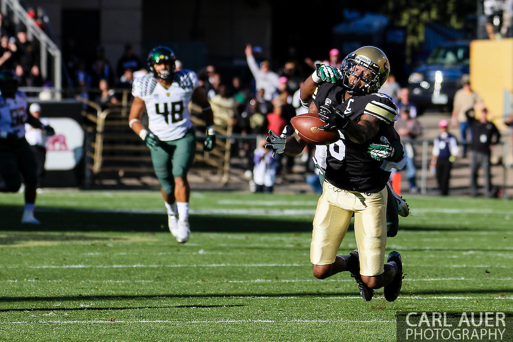October 5th, 2013:  With a Oregon Duck defender on his back, Colorado Buffaloes junior wide receiver Paul Richardson (6) dives for the ball in first quarter action of the NCAA football game between the University of Oregon Ducks and the Colorado Buffaloes at Folsom Field in Boulder, Colorado