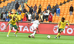 South Africa: Johannesburg: Bafana Bafana players Sandile Hlanti and Percy Tau battle for the ball with Seychelles player Jude Nancy during the Africa Cup Of Nations qualifiers at FNB stadium, Gauteng.<br />