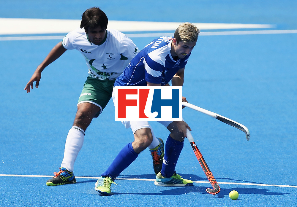 LONDON, ENGLAND - JUNE 19: Muhammad Aleem Bilal of Pakistan and Lee Morton of Scotland battle for possession during the Pool B match between Scotland and Pakistan on day five of Hero Hockey World League Semi-Final at Lee Valley Hockey and Tennis Centre on June 19, 2017 in London, England.  (Photo by Alex Morton/Getty Images)