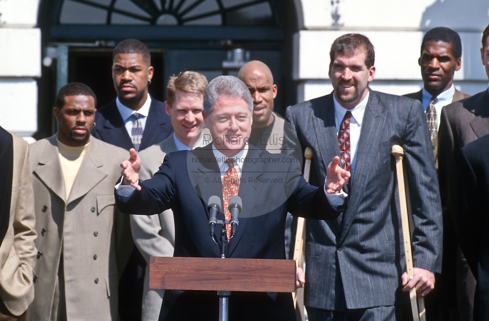 President Bill Clinton congratulates the NBA Champion Chicago Bulls during an event on the South Lawn of the White House April 3, 1997.