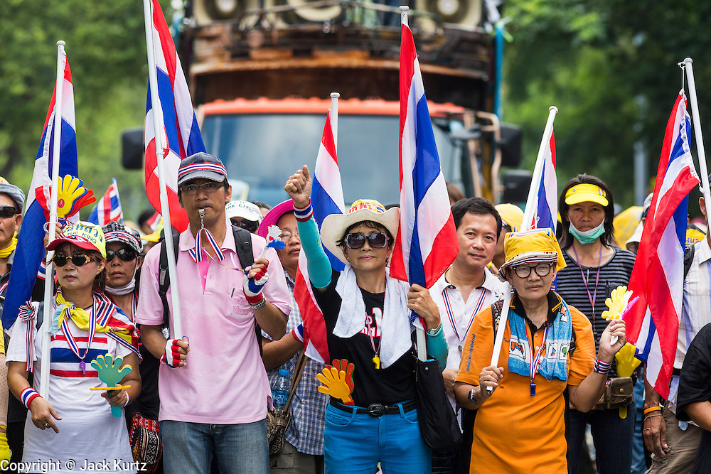 26 NOVEMBER 2013 - BANGKOK, THAILAND: Anti-government protestors in Bangkok march down a street to go to Parliament to protest against Prime Minister Yingluck Shinawatra. The protestors voluntrarily changed their route to avoid a confrontation with police. Protestors opposed to the government of Thai Prime Minister Yingluck Shinawatra spread out through Bangkok this week. Protestors have taken over the Ministry of Finance, Ministry of Sports and Tourism, Ministry of the Interior and other smaller ministries. The protestors are demanding the Prime Minister resign, the Prime Minister said she will not step down. This is the worst political turmoil in Thailand since 2010 when 90 civilians were killed in an army crackdown against Red Shirt protestors. The Pheu Thai party, supported by the Red Shirts, won the 2011 election and now govern. The protestors demanding the Prime Minister step down are related to the Yellow Shirt protestors that closed airports in Thailand in 2008.     PHOTO BY JACK KURTZ