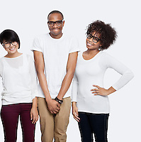 Portrait of young multi-ethnic friends in casuals smiling together over white background