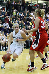 29 January 2011: Brittany Hasselbring heads inside guarded by Kristi Schmidt during an NCAA Womens basketball game between the Carthage Reds and the Illinois Wesleyan Titans at Shirk Center in Bloomington Illinois.