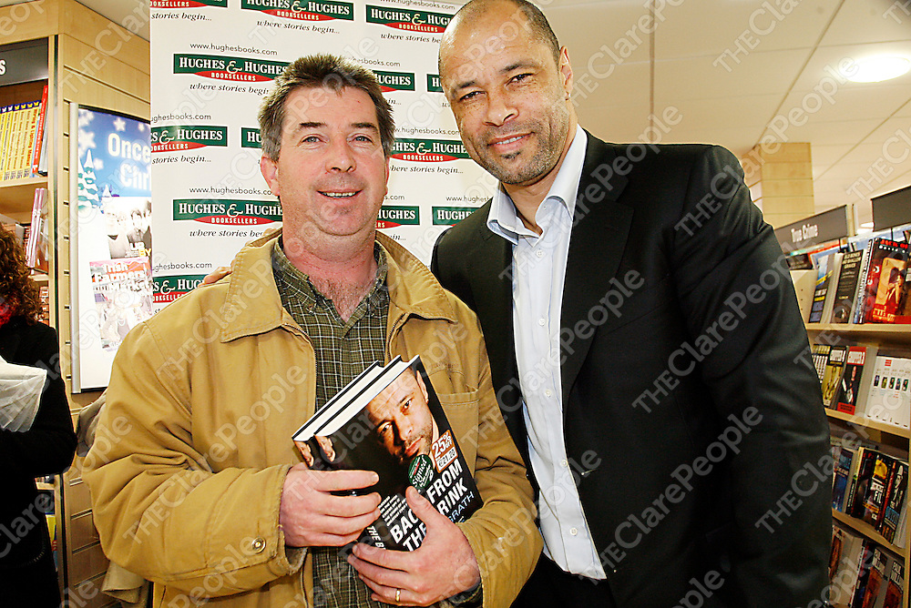 Mike Twomey with soccer legend Paul McGrath in Hughs and Hughs where he was signing copies of his book 'Back From The Brink' on Wednesday.<br />