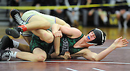 Pennridge's Josh Stillings (bottom) wrestles with Upper Darby's Colin Cronin during the 132 pound match at the Southeast Class AAA wrestling regionals at Oxford High School Saturday, February 28, 2015 in Oxford, Pennsylvania.  Cronin defeated Stillings for the championship. (Photo by William Thomas Cain/Cain Images)