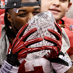 Jan 9, 2012; New Orleans, LA, USA; Alabama Crimson Tide running back Trent Richardson (3) celebrates with The Coaches Trophy crystal football after the 2012 BCS National Championship game win over the LSU Tigers at the Mercedes-Benz Superdome.  Mandatory Credit: Derick E. Hingle-US PRESSWIRE