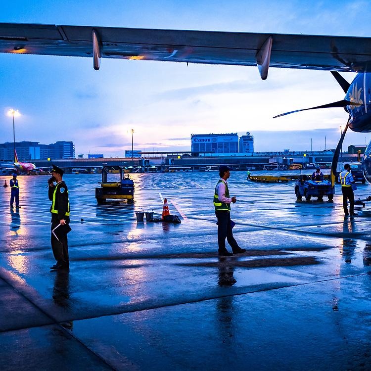 An early morning wet tarmac at Tan Son Nhat airport, Ho Chi Minh City, Vietnam.