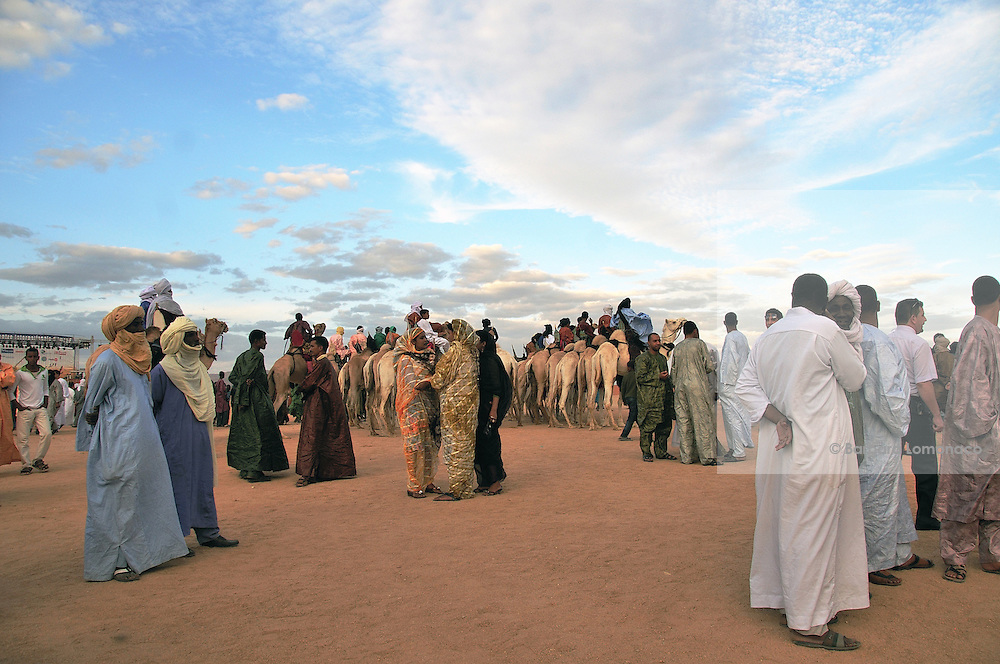 "Tuareg men and women waiting for the beginning of the ""III Rencontre International d'Imzad"". Tamanrasset, Algeria. November 2011"