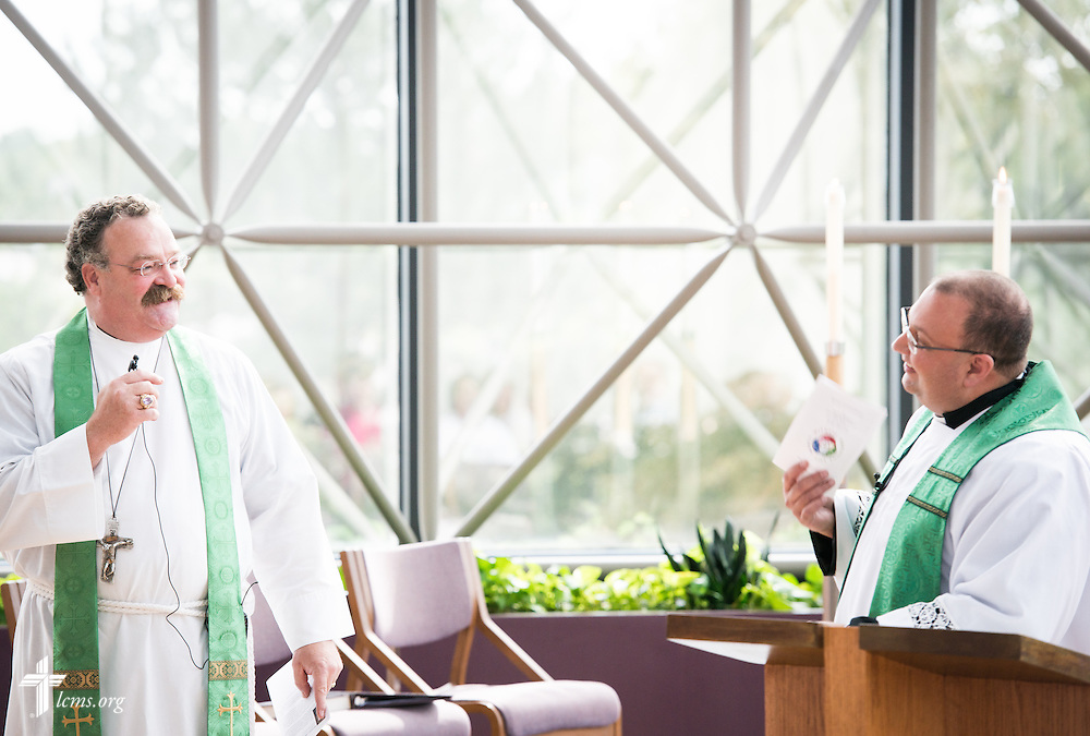 The Rev. Dr. Matthew C. Harrison, president of The Lutheran Church–Missouri Synod, jokes with the Rev. Bart Day, interim Chief Mission Officer and executive director in Office of National Mission, during a Service of Installation in the International Center chapel of The Lutheran Church–Missouri Synod on Wednesday, Sept. 3, 2014, in Kirkwood, Mo. LCMS Communications/Erik M. Lunsford