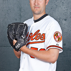 February 26, 2011; Sarasota, FL, USA; Baltimore Orioles pitcher Justin Duchscherer (58) poses during photo day at Ed Smith Stadium.  Mandatory Credit: Derick E. Hingle
