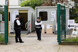 © Licensed to London News Pictures. 03/05/2018. London, UK. Police presence at a polling station in Tower Hamlets, where extra security measures are in place for voting in local elections today. Photo credit: Vickie Flores/LNP