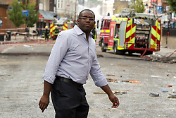 © Licensed to London News Pictures . FILE PICTURE DATED 07/08/2011 . Tottenham , UK . Tottenham MP David Lammy arrives to scenes of destruction on Tottenham High Road following a night of rioting in Tottenham . Photo credit : Joel Goodman/LNP