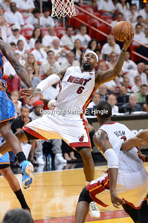 Jun 17, 2012; Miam, FL, USA; Miami Heat small forward LeBron James (6) shoots against the Oklahoma City Thunder during the second half in game three in the 2012 NBA Finals at the American Airlines Arena. Miami won 91-85. Mandatory Credit: Derick E. Hingle-US PRESSWIRE