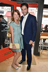 DAVID & GABRIELLA PEACOCK at a party to celebrate the launch of Top Dog at 48 Frith Street, Soho, London on 27th May 2015