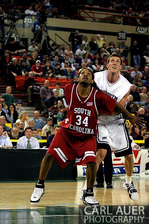 25 November 2005: USC junior forward, Renaldo Balkman (34), and Monmouth's junior center, Corey Hallett (13) in the South Carolina 62-56 victory over Monmouth University at the Great Alaska Shootout in Anchorage, Alaska