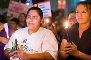 11 OCTOBER 2010 - PHOENIX, AZ:  Women participate in a candle light march around Phoenix police headquarters Monday night. About 300 people gathered at the Phoenix Police Department headquarters building Monday night to protest the shooting of Daniel Rodriguez and his dog. The officers responded to a 911 call made by Rodriguez' mother. A scuffle ensued when they arrived and Phoenix police officer Richard Chrisman shot Rodriguez, who was unarmed, and his dog. Chrisman then allegedly filed a false report about the event. He has been arrested on felony assault charges. The event has angered some in the Latino community and they have held a series of protests at the police headquarters. They want Chrisman charged with murder.    Photo by Jack Kurtz