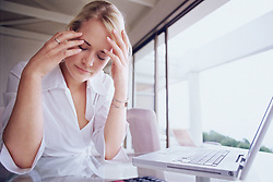 Dec. 14, 2012 - Woman looking stressed (Credit Image: © Image Source/ZUMAPRESS.com)