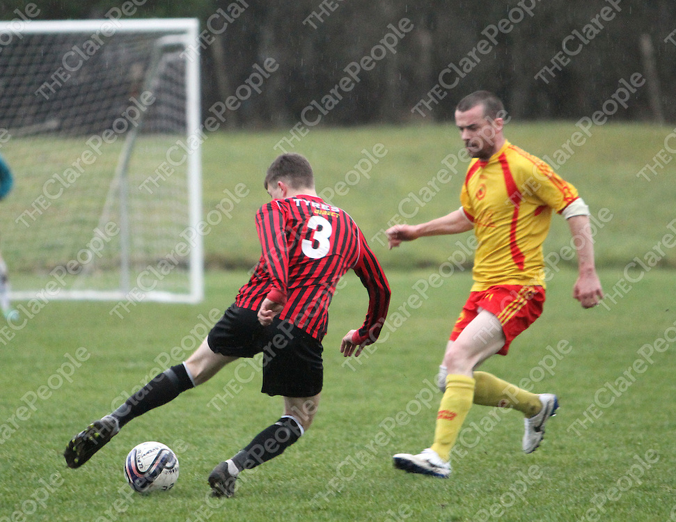 5/1/14 Bridge Uniteds Brian Monaghan side steps Avenue Uniteds Barry Nugent in Roslevan when the two sides met at the weekend. Pic Tony Grehan / Press 22