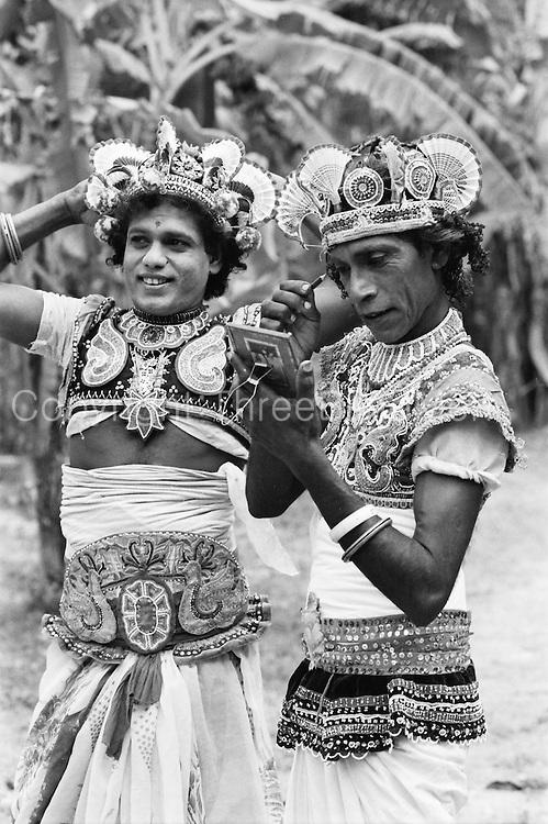 Dancers preparing for the Nawam Perahera (procession) in Colombo.<br /> 1993.