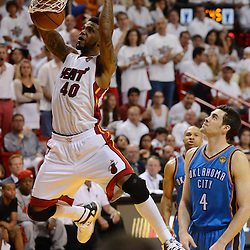 Jun 17, 2012; Miam, FL, USA; Miami Heat power forward Udonis Haslem (40) dunks against the Oklahoma City Thunder during the second half in game three in the 2012 NBA Finals at the American Airlines Arena. Miami won 91-85. Mandatory Credit: Derick E. Hingle-US PRESSWIRE