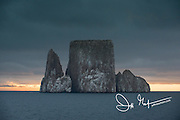 Dark skys over Kicker Rock (Leon Dormido) part of the Galapagos Islands of Ecuador.