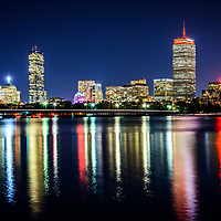 Boston skyline at night with Back Bay buildings, Harvard Bridge, Charles River, John Hancock Tower, and Prudential Tower. Boston Massachusetts is a major city in the Eastern United States of America.