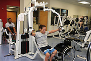 University of Arizona student Jennifer Poist works out at the campus Disability Resource Center.  Poist is on the university's wheelchair basketball team in Tucson, Arizona, USA.
