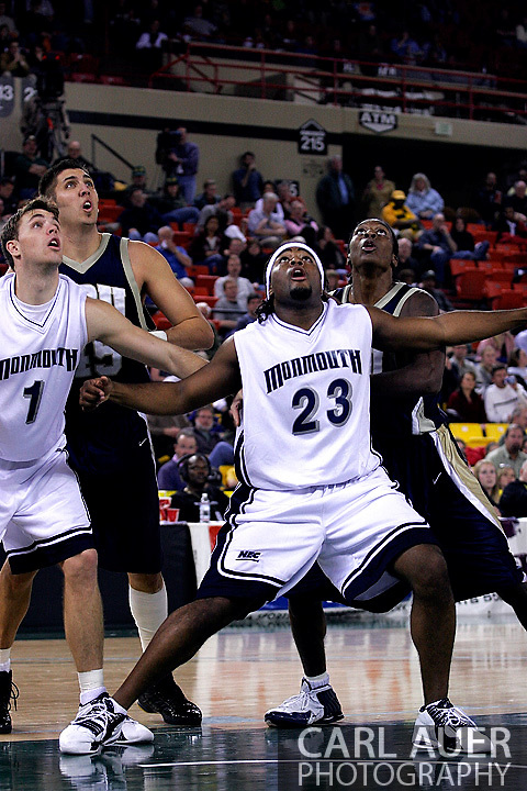 26 November 2005: MU junior Marques Alston (23) and junior Dejan Delic (1) block out Mickey Michalec and Larry Owens in the Monmouth University 54-62 loss to Oral Roberts University at the Great Alaska Shootout in Anchorage, Alaska