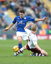 Leicester City's Matthew James is tackled by Burnley's Ben Mee - Photo mandatory by-line: Nigel Pitts-Drake/JMP - Tel: Mobile: 07966 386802 14/12/2013 - SPORT - Football - Leicester - King Power Stadium - Leicester City v Burnley - Sky Bet Championship