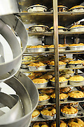 Industrial Bakery pies cooling in cooling racks after baking