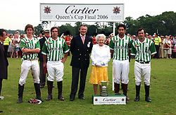 HM THE QUEEN ELIZABETH 11 and ARNAUD BAMBERGER MD of Cartier with the victorious Dubai polo team at the Queen's Cup polo final sponsored by Cartier at Guards Polo Club, Smith's Lawn, Windsor Great Park on 18th June 2006.  The Final was between Dubai and the Broncos polo teams with Dubai winning.<br />