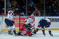 KELOWNA, CANADA - NOVEMBER 17: Stuart Skinner #74 of the Lethbridge Hurricanes defends the net as Dillon Dube #19 of the Kelowna Rockets slides into the crease during first period on November 17, 2017 at Prospera Place in Kelowna, British Columbia, Canada.  (Photo by Marissa Baecker/Shoot the Breeze)  *** Local Caption ***