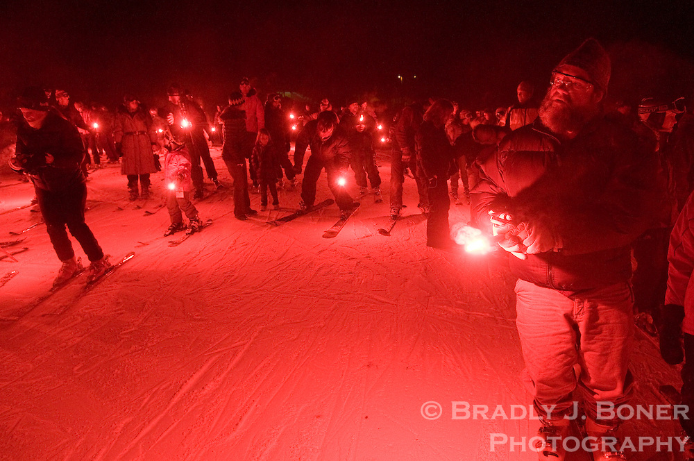 BRADLY J. BONER / NEWS&GUIDE.Participants of a torchlight parade gather at the base of Snow King Mountain after descending the mountain to kick off a memorial for the late Jimmy Zell on Tuesday night. Hundreds gathered to remember Zell's life and times in the Tetons.
