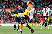 Preston North End defender Greg Cunningham (3) and Brentford midfielder Lewis Macleod (4) battle for the ball during the EFL Sky Bet Championship match between Brentford and Preston North End at Griffin Park, London, England on 17 September 2016. Photo by Andy Walter.