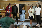 "Francesca Zambello, Creative and General Director for the Glimmerglass Festival, and performers Norman Garrett, Talise Trevigne, Meroë Khalia Adeeb, and Musa Ngqungwana take questions from inmates at Attica Correctional Facility in Attica, New York on Tuesday, July 25, 2017. The Glimmerglass Festival, an opera company in Cooperstown, New York, performed songs from George Gershwin's ""Porgy and Bess"" for inmates."