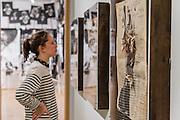 The Reading Room. Peter Kennard: Unofficial War Artist - Retrospective Exhibition of British Political and anti-war artist at IWM London, UK 12 May 2015
