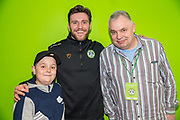 Forest Green Rovers goalkeeper James Montgomery with his sponsors during the EFL Sky Bet League 2 match between Forest Green Rovers and Carlisle United at the New Lawn, Forest Green, United Kingdom on 16 March 2019.