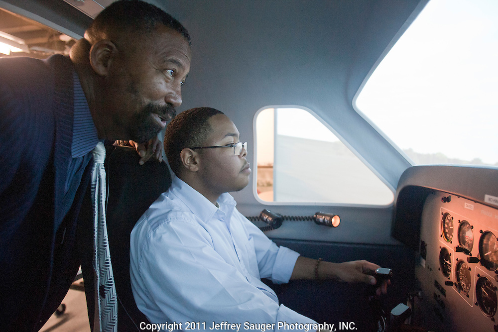DETROIT, MI - NOVEMBER, 15: Robert C. Bobb, Emergency Financial Manager of the 87,000-student Detroit Public Schools, left, watches senior Victor Landry, 17, fly a flight simulator during a surprise visit to Davis Aerospace Technical High School, in Detroit, MI, Monday, November 15, 2010. (Photo by Jeffrey Sauger)