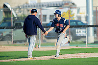 KELOWNA, BC - JULY 17: Ryan Altenberger #1 of the Wenatchee Applesox gets a low five from the third base coach as he runs home after hitting a home run against the the Kelowna Falcons at Elks Stadium on July 17, 2019 in Kelowna, Canada. (Photo by Marissa Baecker/Shoot the Breeze)