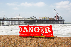 © Licensed to London News Pictures. 08/06/2019. Brighton, UK. Danger signs can be seen on the beach in Brighton and Hove as rough seas and strong winds hit the Brighton and Hove beach on Saturday morning in the aftermath of storm Miguel. Photo credit: Hugo Michiels/LNP