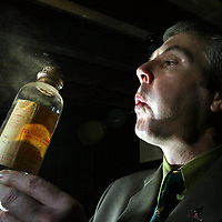 Derek Brown, Brands Heritage Manager dusts off bottles in the cellar of Glenturret Distillery in Crieff where they will be holding a whisky sale.<br />