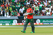 Wicket - Mushfiqur Rahim (wk) of Bangladesh looks dejected as he walks back to the pavilion after being dismissed by Wahab Riaz of Pakistan during the ICC Cricket World Cup 2019 match between Pakistan and Bangladesh at Lord's Cricket Ground, St John's Wood, United Kingdom on 5 July 2019.