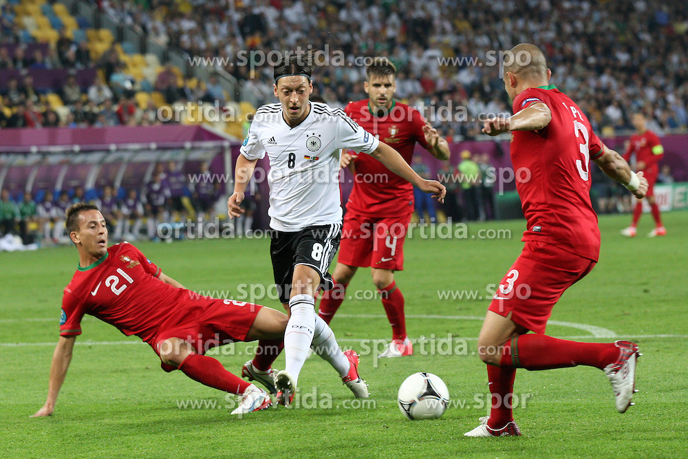 09.06.2012, Arena Lwiw, Lemberg, UKR, UEFA EURO 2012, Deutschland vs Portugal, Gruppe B, im Bild JOAO PEREIRA MESUT OZIL PEPE // during the UEFA Euro 2012 Group B Match between Germany and Portugal at the Arena Lviv, Lviv, Ukraine on 2012/06/09. EXPA Pictures © 2012, PhotoCredit: EXPA/ Newspix/ Piotr Kucza..***** ATTENTION - for AUT, SLO, CRO, SRB, SUI and SWE only *****