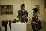 Alex Lambros and Athina Goulandris looking at work by Henry Hudson,  exhibition, 2 Ada St. London E8. 25 October 2006. -DO NOT ARCHIVE-© Copyright Photograph by Dafydd Jones 66 Stockwell Park Rd. London SW9 0DA Tel 020 7733 0108 www.dafjones.com