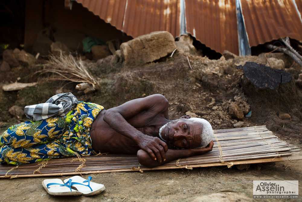 Norbert Edegan, 65, rests on a floormat on the ground next to his destroyed home in the village of Kpoto, Benin on Tuesday October 26, 2010.  Waters have receded in Kpoto, but most of the village was literally flattened by floods that have hit Benin over the past few weeks..