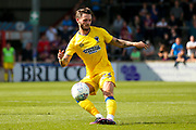 AFC Wimbledon defender Callum Kennedy (23) crosses a free kick to the far post during the EFL Sky Bet League 1 match between Scunthorpe United and AFC Wimbledon at Glanford Park, Scunthorpe, England on 5 August 2017. Photo by Simon Davies.
