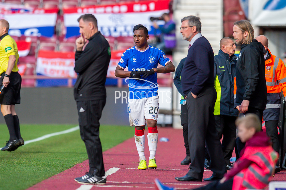 Alfredo Morelos (#20) of Rangers FC walks up the sideline after being substituted during the Ladbrokes Scottish Premiership match between Heart of Midlothian and Rangers FC at Tynecastle Park, Edinburgh, Scotland on 20 October 2019.