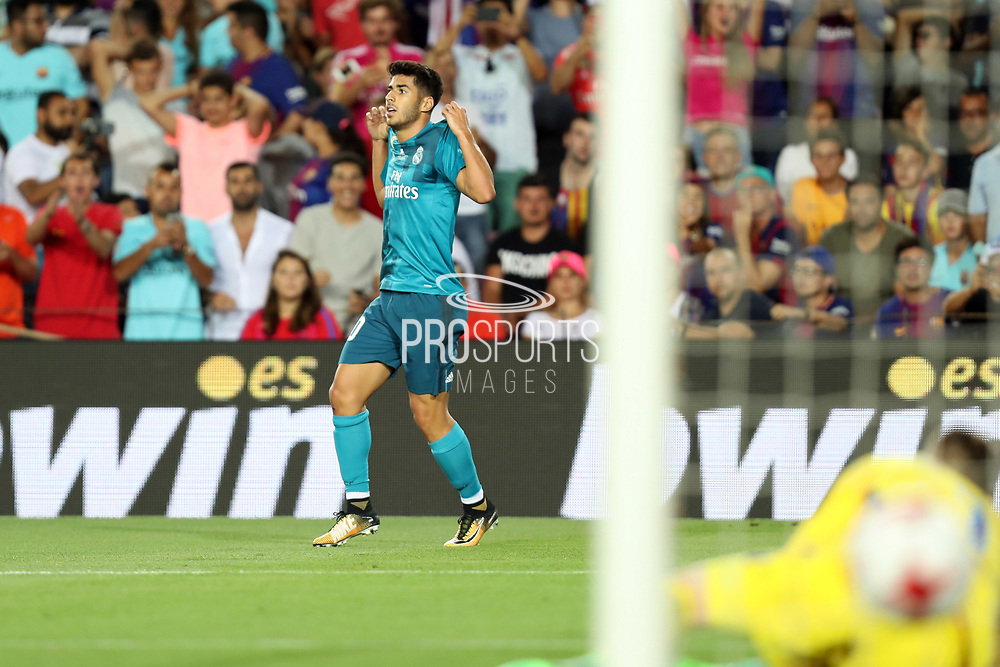 Marco Asensio of Real Madrid celebrates after scoring his side's third goal during the Spanish Super Cup football match between FC Barcelona and Real Madrid on August 13, 2017 at Camp Nou stadium in Barcelona, Spain. - Photo Manuel Blondeau / AOP Press / ProSportsImages / DPPI